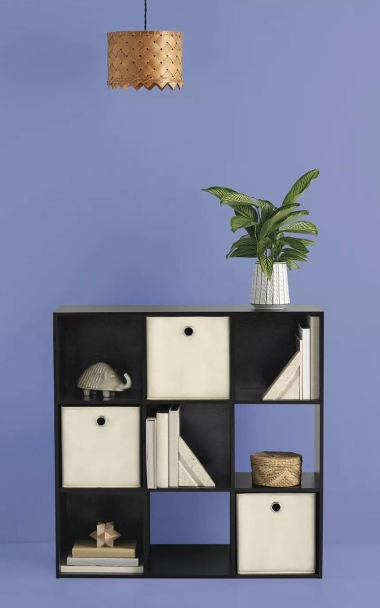 cube organizer shelf on a purple background
