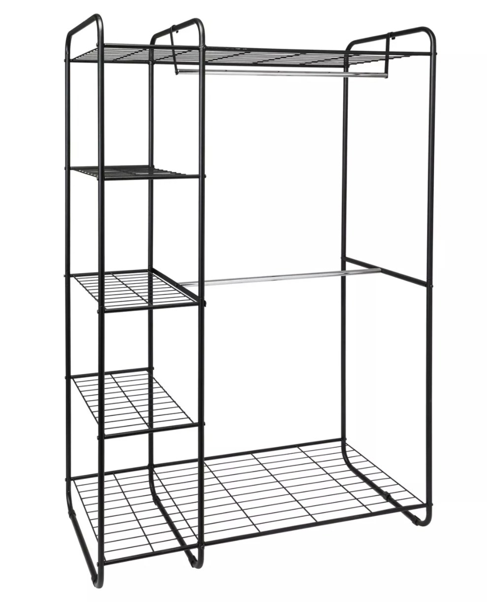 A black freestanding metal garment rack