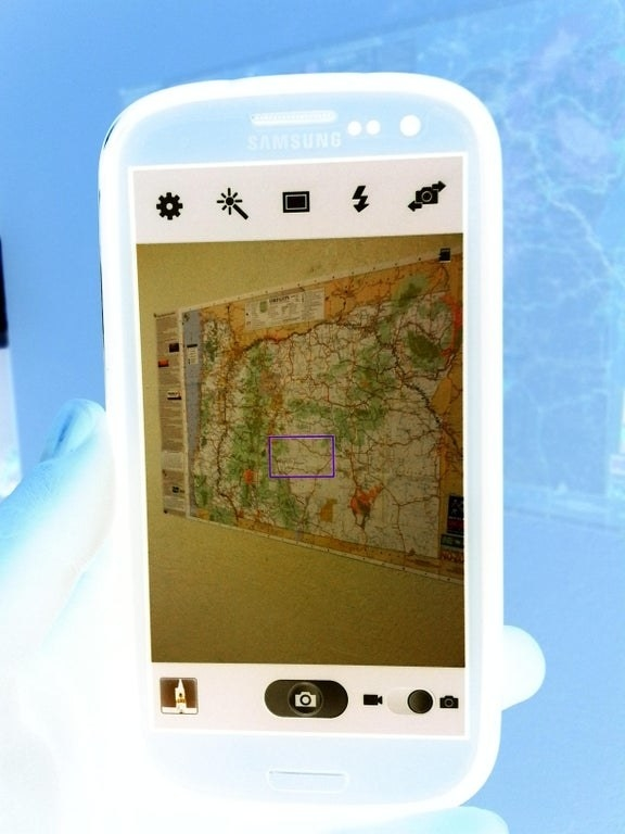A negative photo of a negative photo of a map on a cell phone makes the map show up perfectly clear
