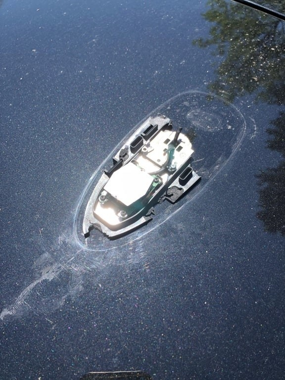 A broken car antenna strongly resembles a boat partially submerged in water