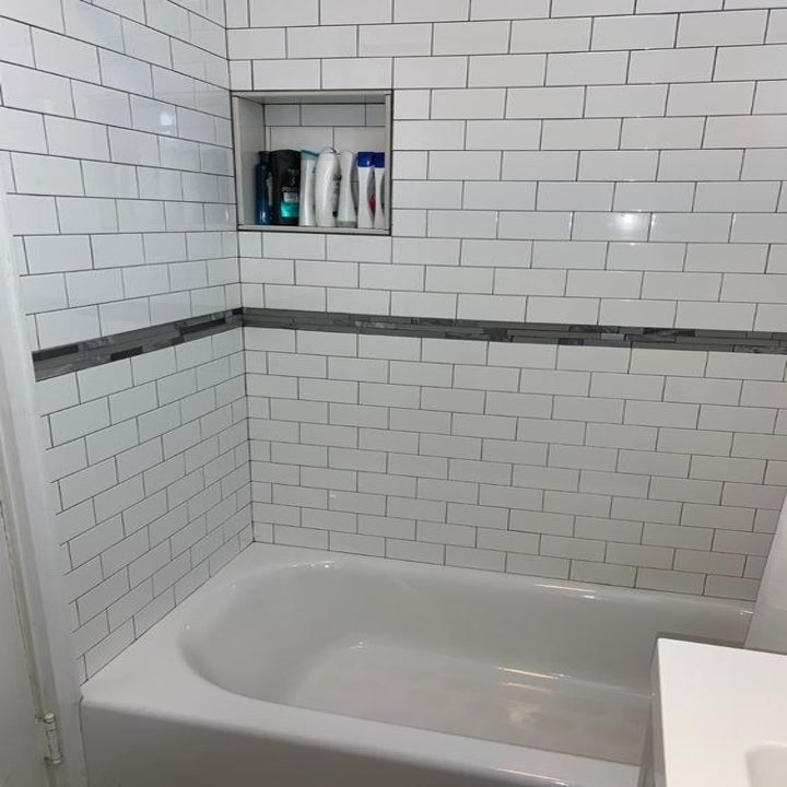 Same reviewer's after picture of perfectly white shower tiles