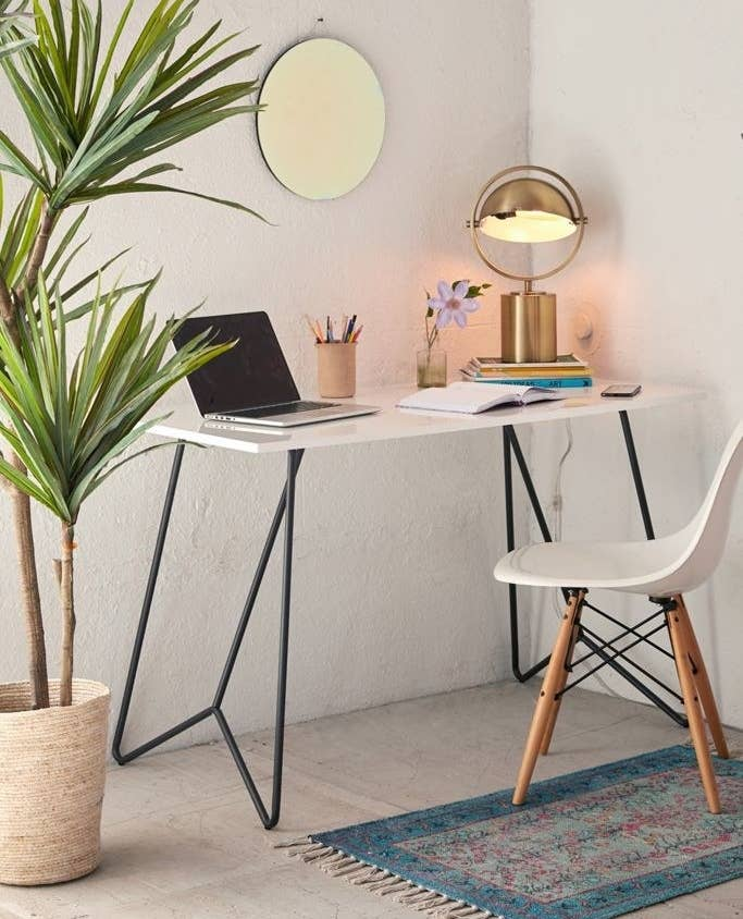 White top desk with black metal tubing legs
