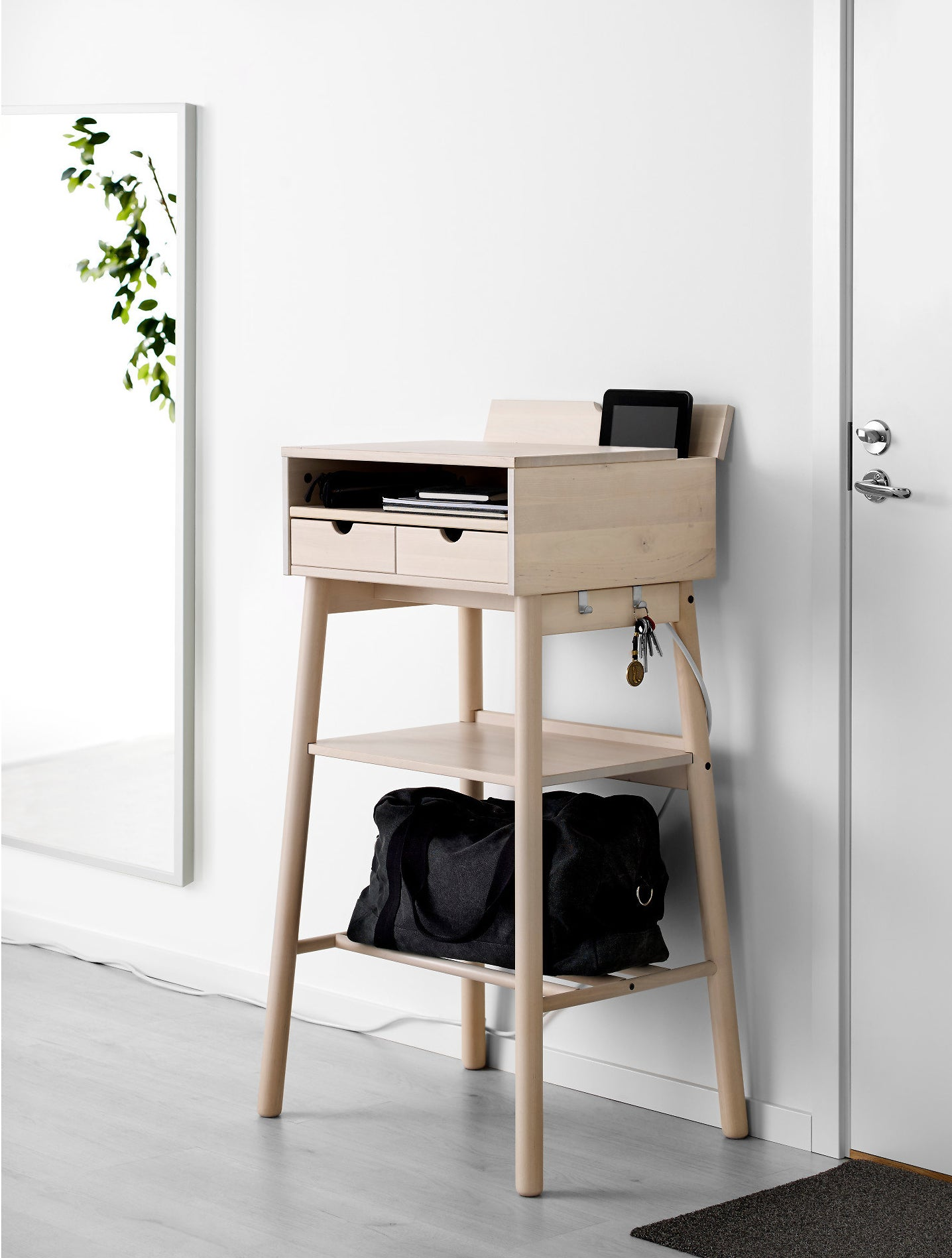 Wood standing desk with two shelves in the legs, a shelf in the desk and two small drawers and two hooks on the side