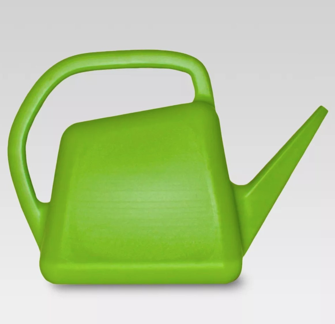 A bright green plastic watering can