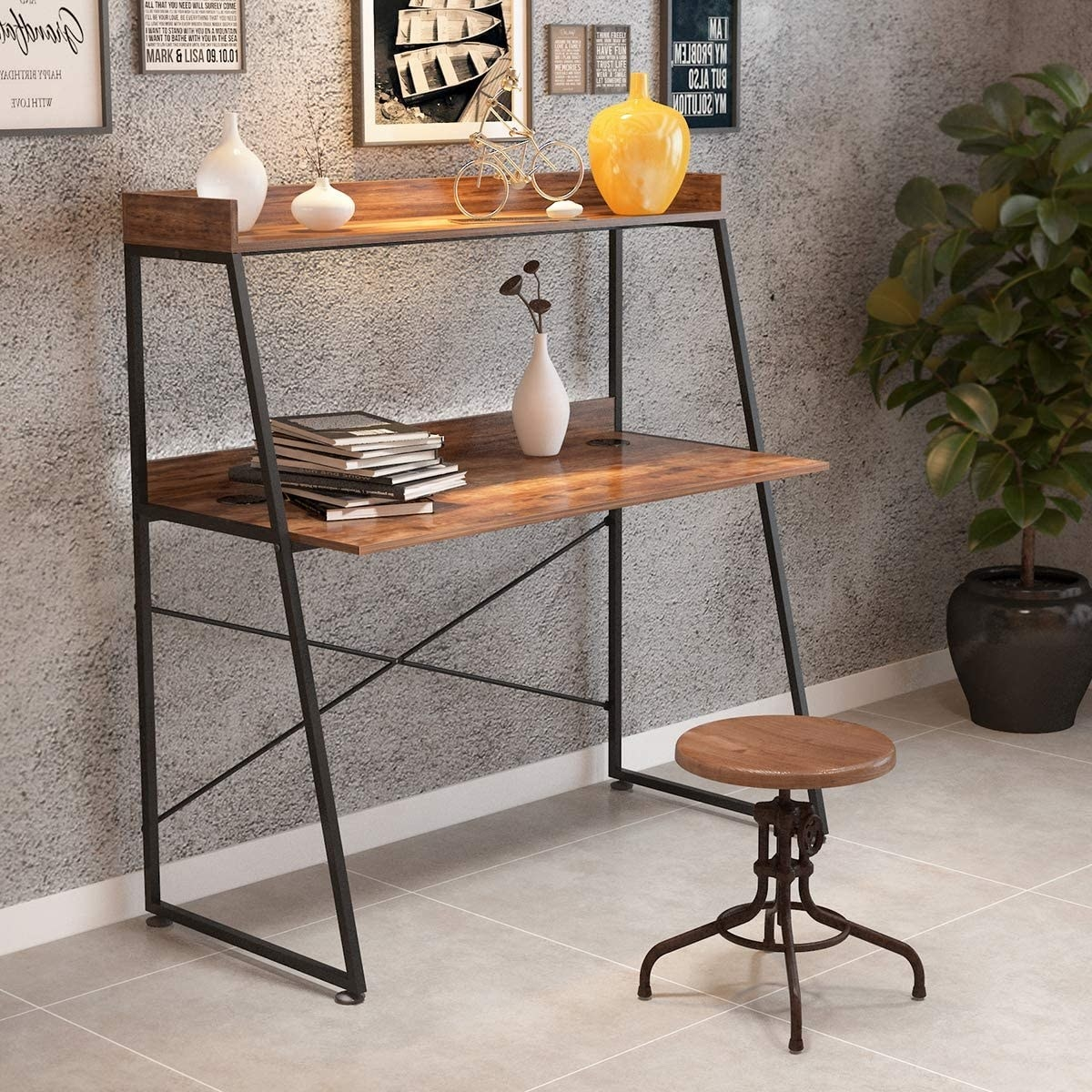 Wood-like desk with shelf above it with trinkets on it and black metal triangle legs