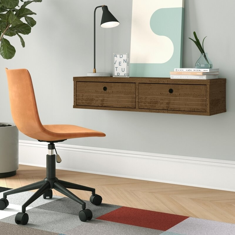 Brown rectangle desk attached to the wall with two big drop-down shelves on the front