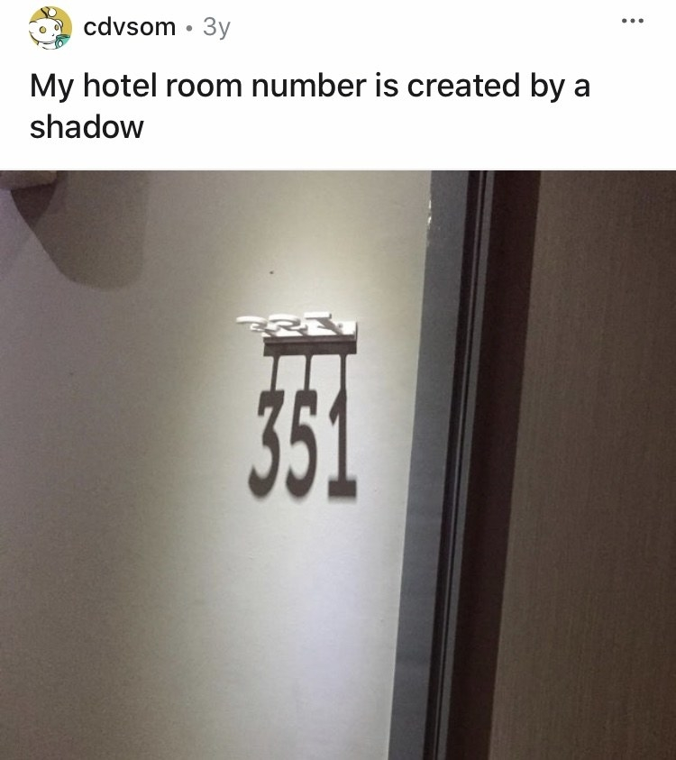 A hotel displays their room numbers by casting shadows on the wall with the room number