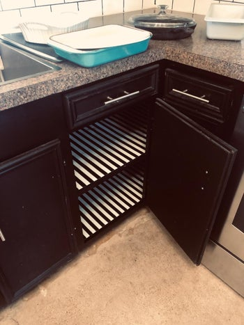 reviewer's cabinets lined with black and white striped liner