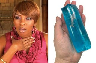 A woman looking shocked next to a water wiggler toy