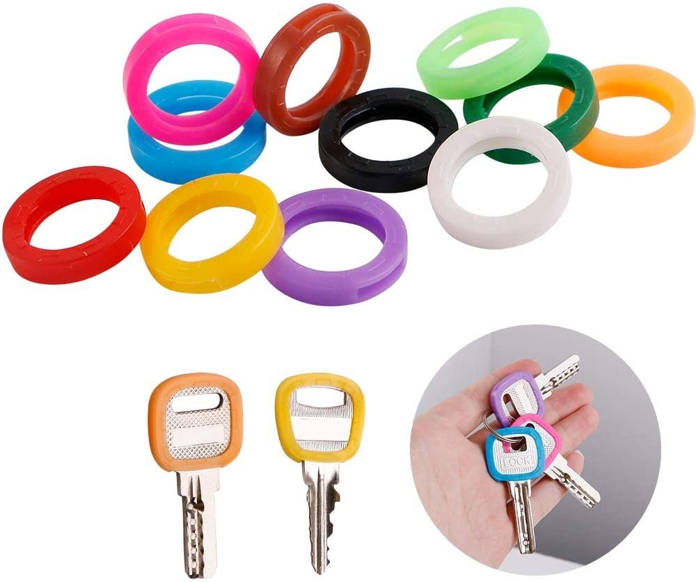 A bunch of round plastic key covers in different colours