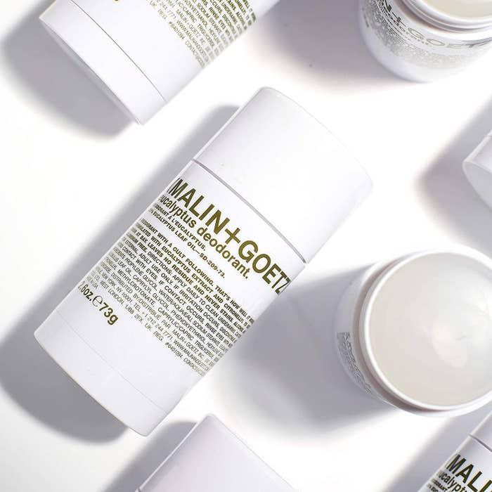 Styled product photo showing Malin + Goetz natural eucalyptus deodorant