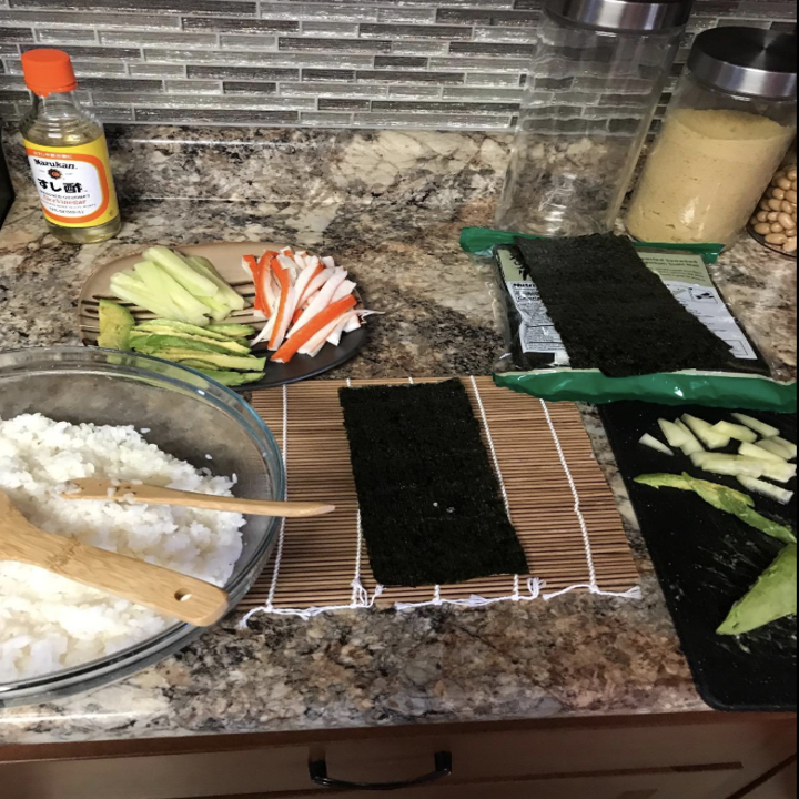 Reviewer image of ingredients for sushi laid out with sushi rolling mat