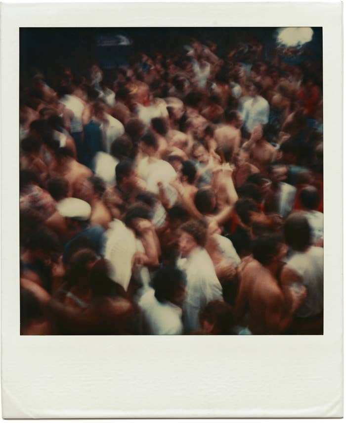 A polaroid provided by the artist Tom Bianchi of a Fire Island party packed with people from his collection of work documenting life on the island from 1970 to 1983