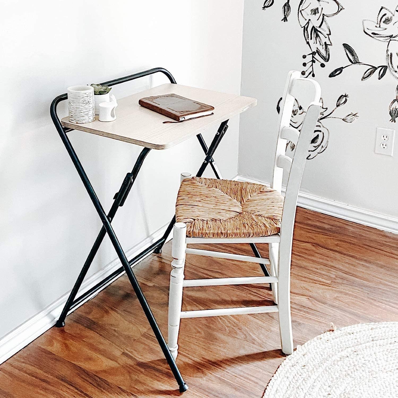 Wood-top desk with black metal crossing legs