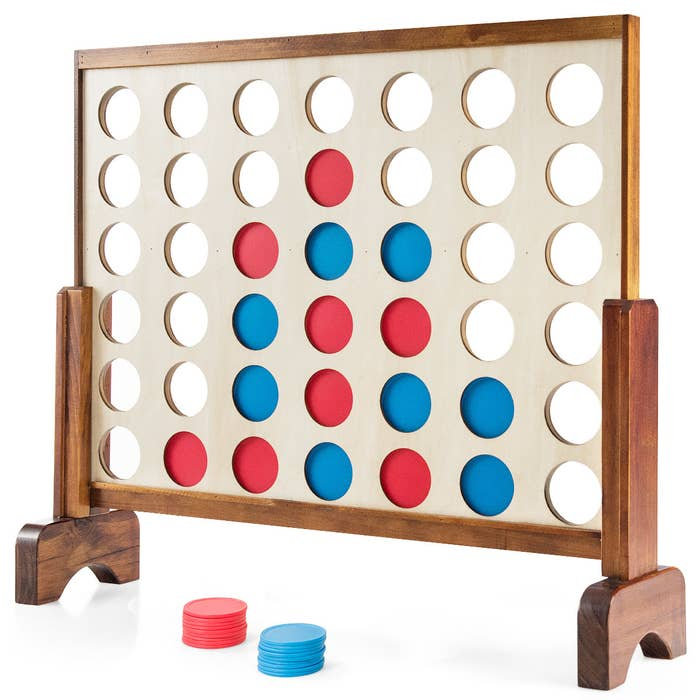 The Costway Giant 4 in a Row Game with red and blue circular pieces