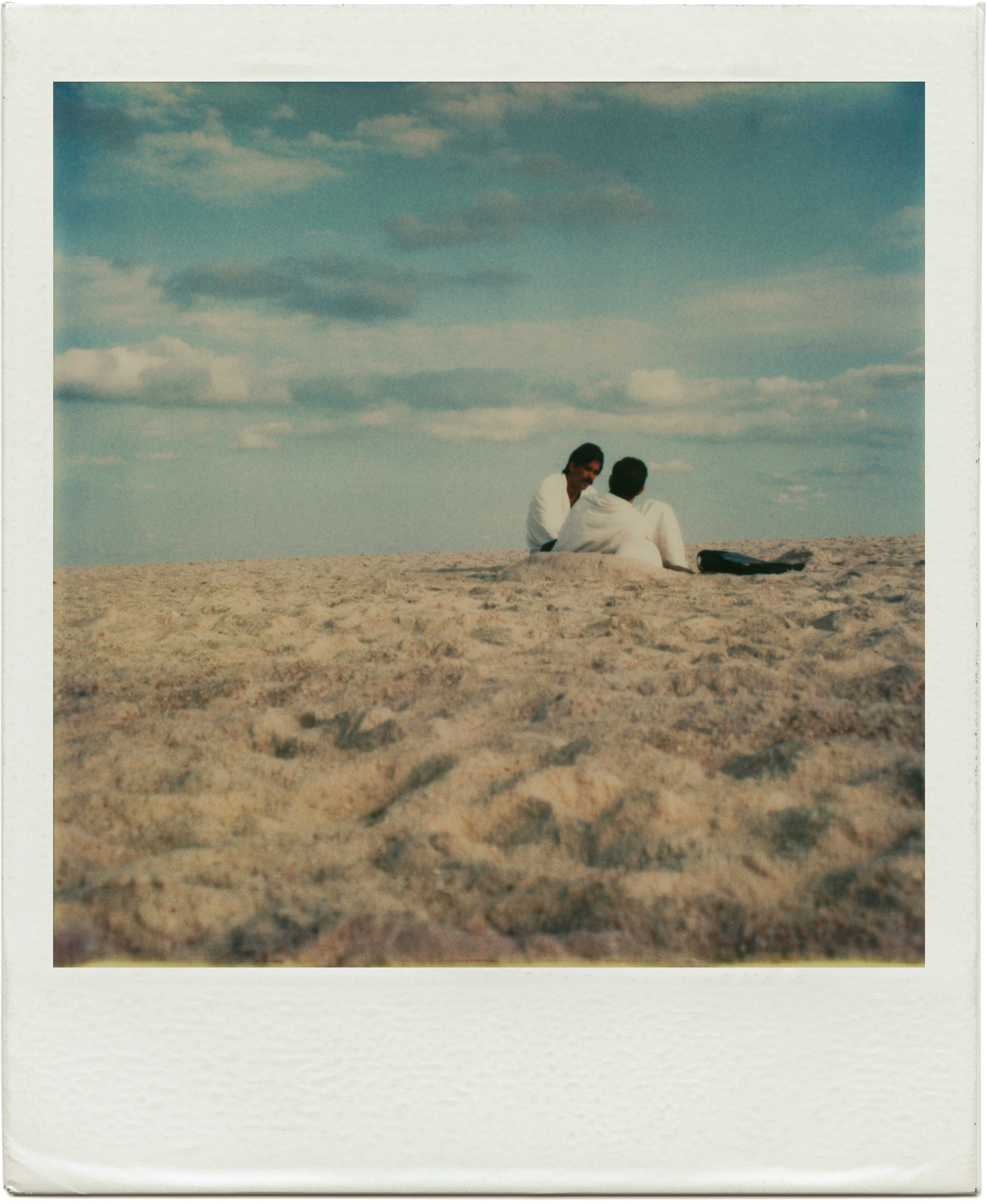 A polaroid provided by the artist Tom Bianchi of two men on a Fire Island beach from his collection of work documenting life on the island from 1970 to 1983