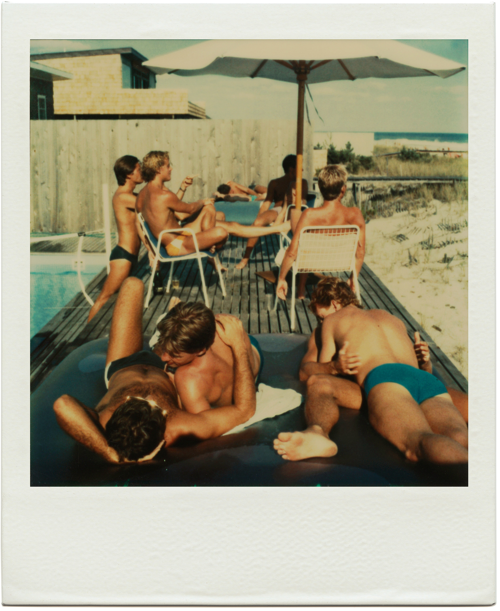 A polaroid provided by the artist Tom Bianchi of a group of men hanging by a pool