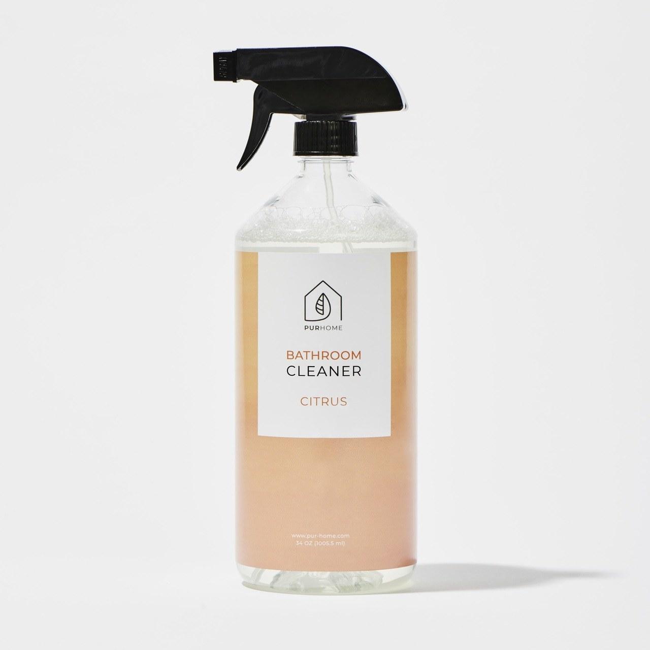 spray bottle of citrus bathroom cleaner