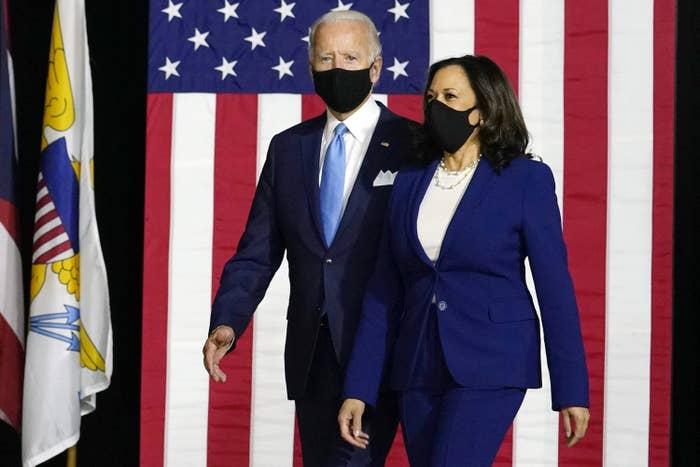 Joe Biden and Kamala Harris in front of the American Flag