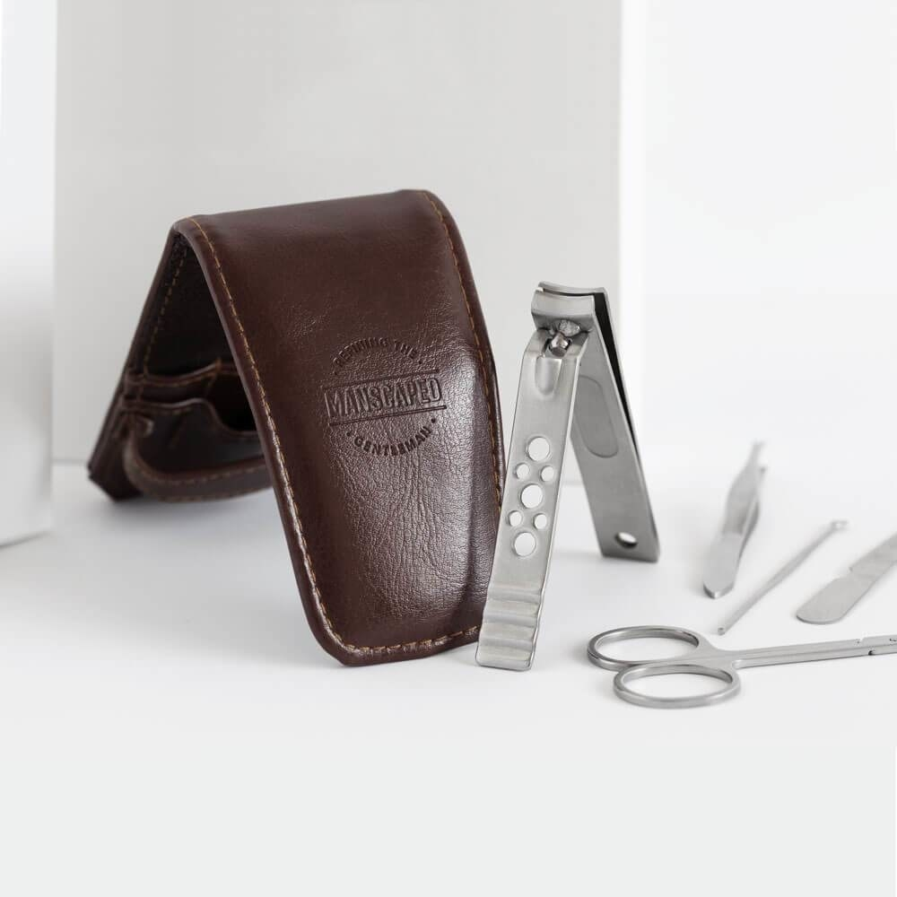 mail grooming kit with brown leather case