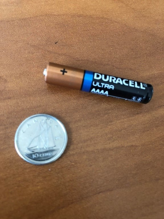 A Duracell battery labeled AAAA that's skinnier than the traditional double A or triple A batteries