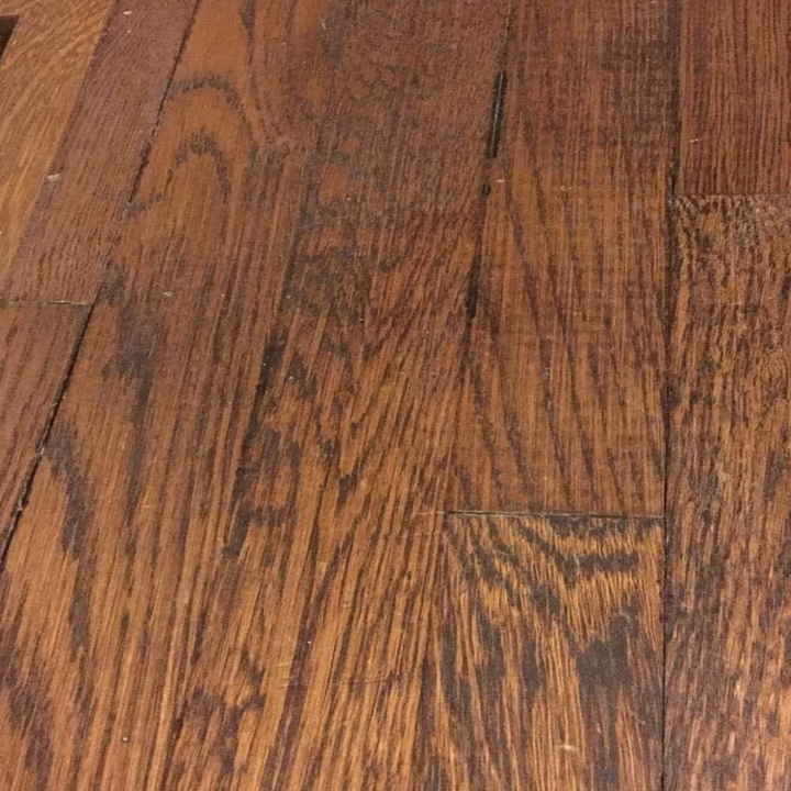 Same reviewer's floor showing less noticeable scratches after using the marker