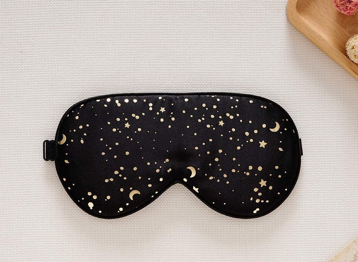 A sleep mask with stars dors and crescent moons