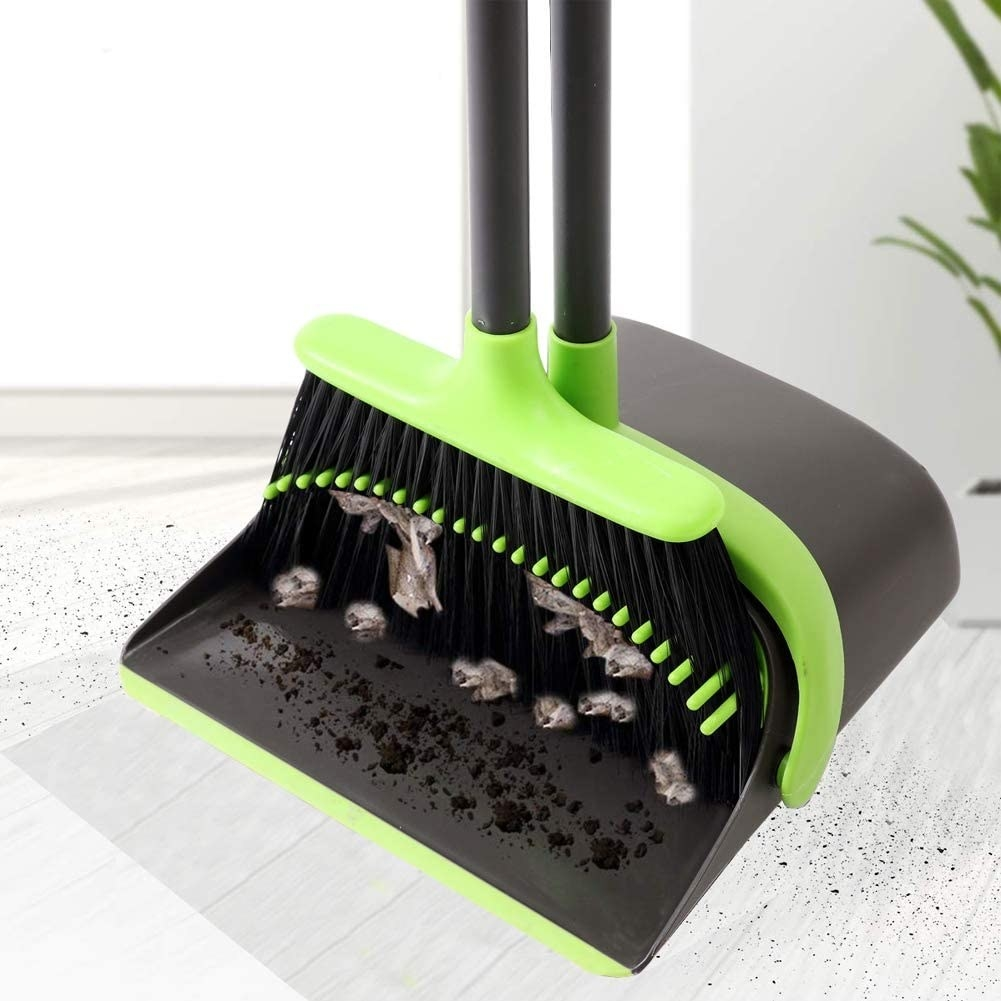 a broom and dustpan set filled with dirt and dust bunnies