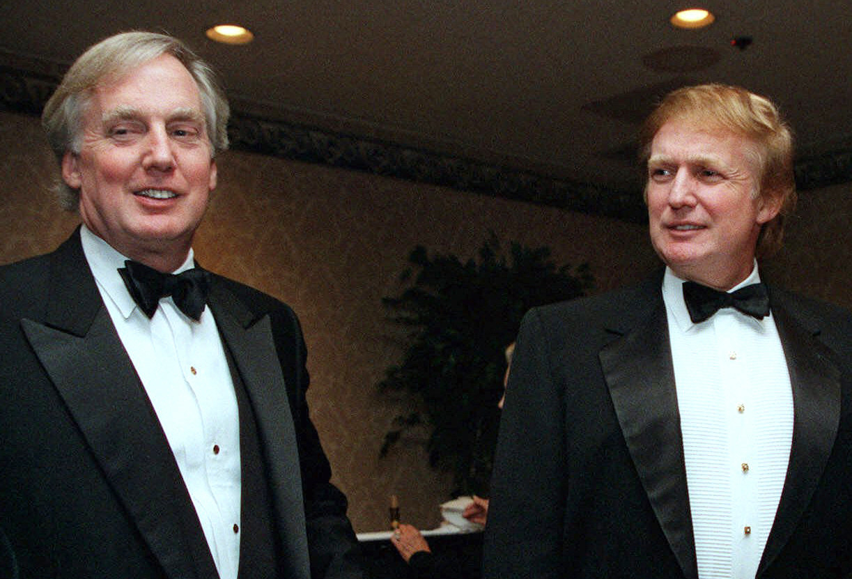 Donald Trump and Robert Trump are smiling while dressed in tuxedos