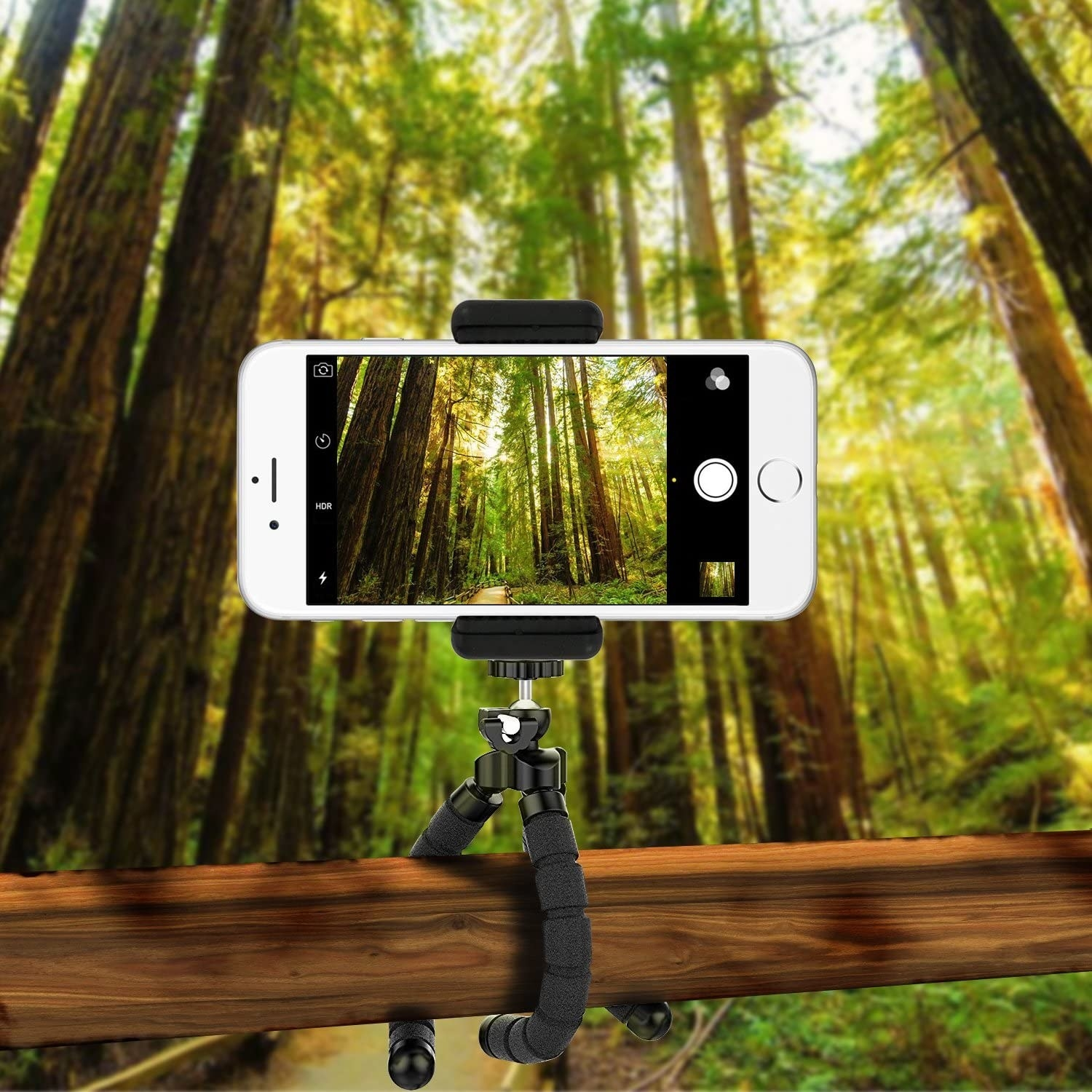 A phone tripod holding an iPhone attached to a wood railing