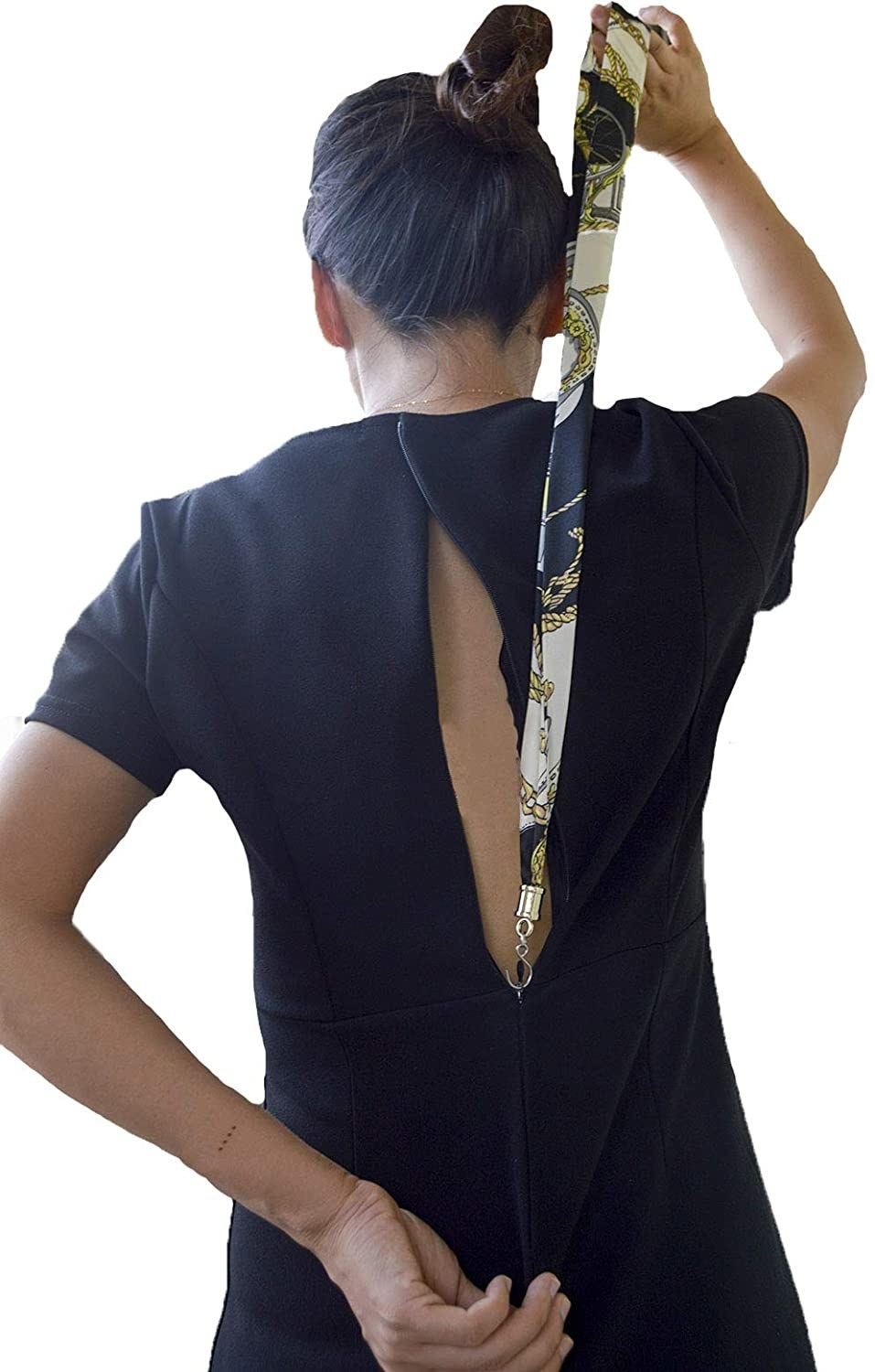 A person uses the tool to zip up the back of their dress