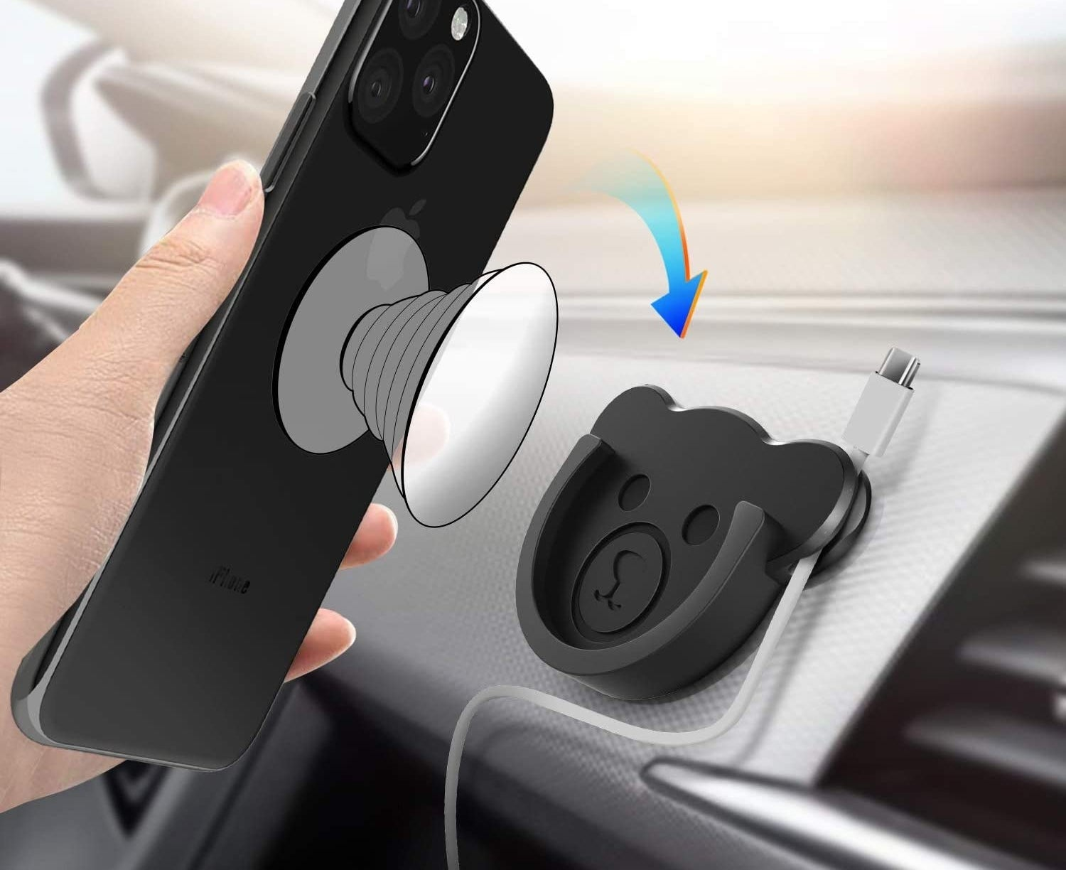 A person placing their phone socket into the bear-shaped phone mount