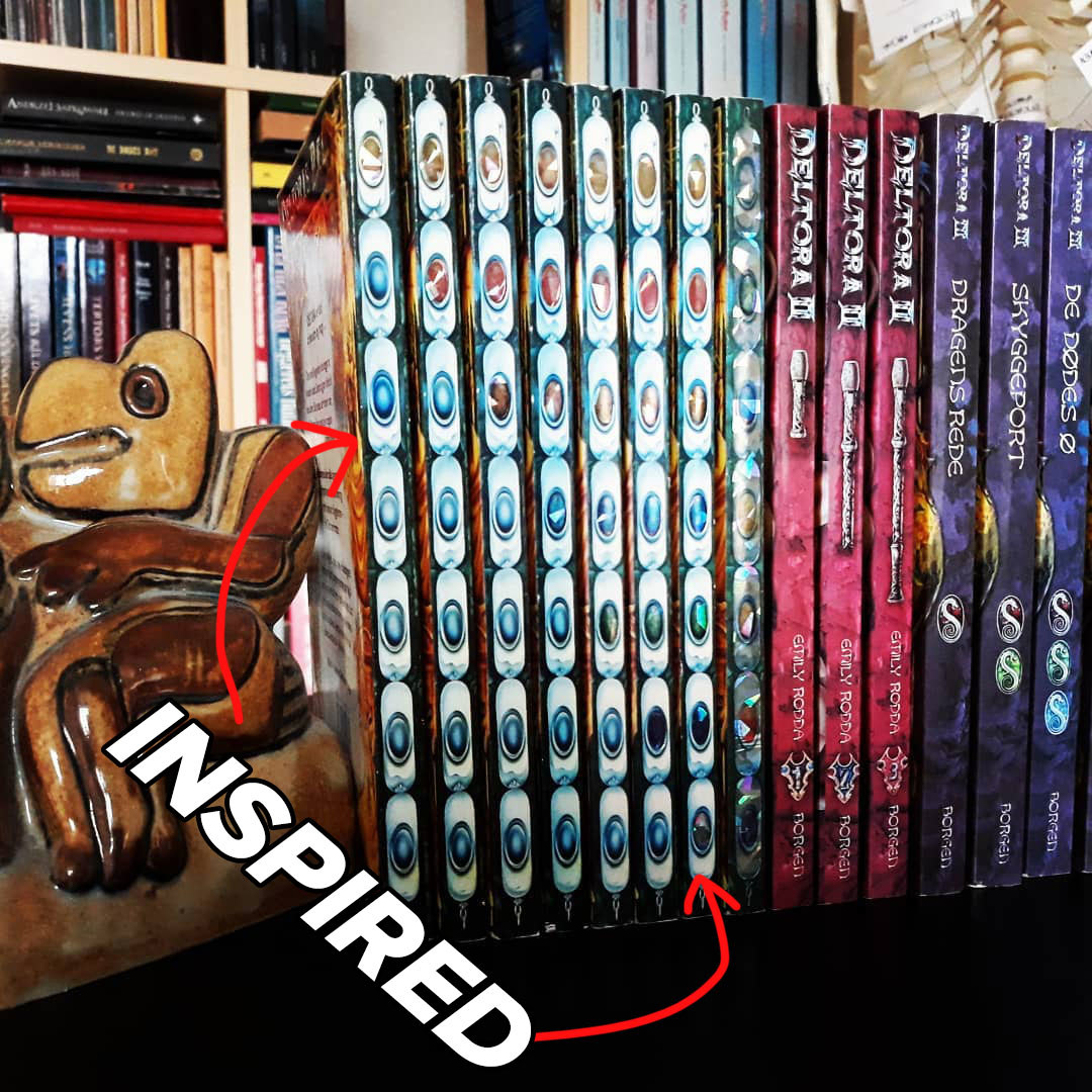 The books spines of the Deltora Quest series, showing the gemstones.