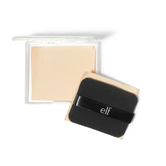 The case with the beige blotting papers in it and then the square black sponge next to it with a blotting paper attached to it
