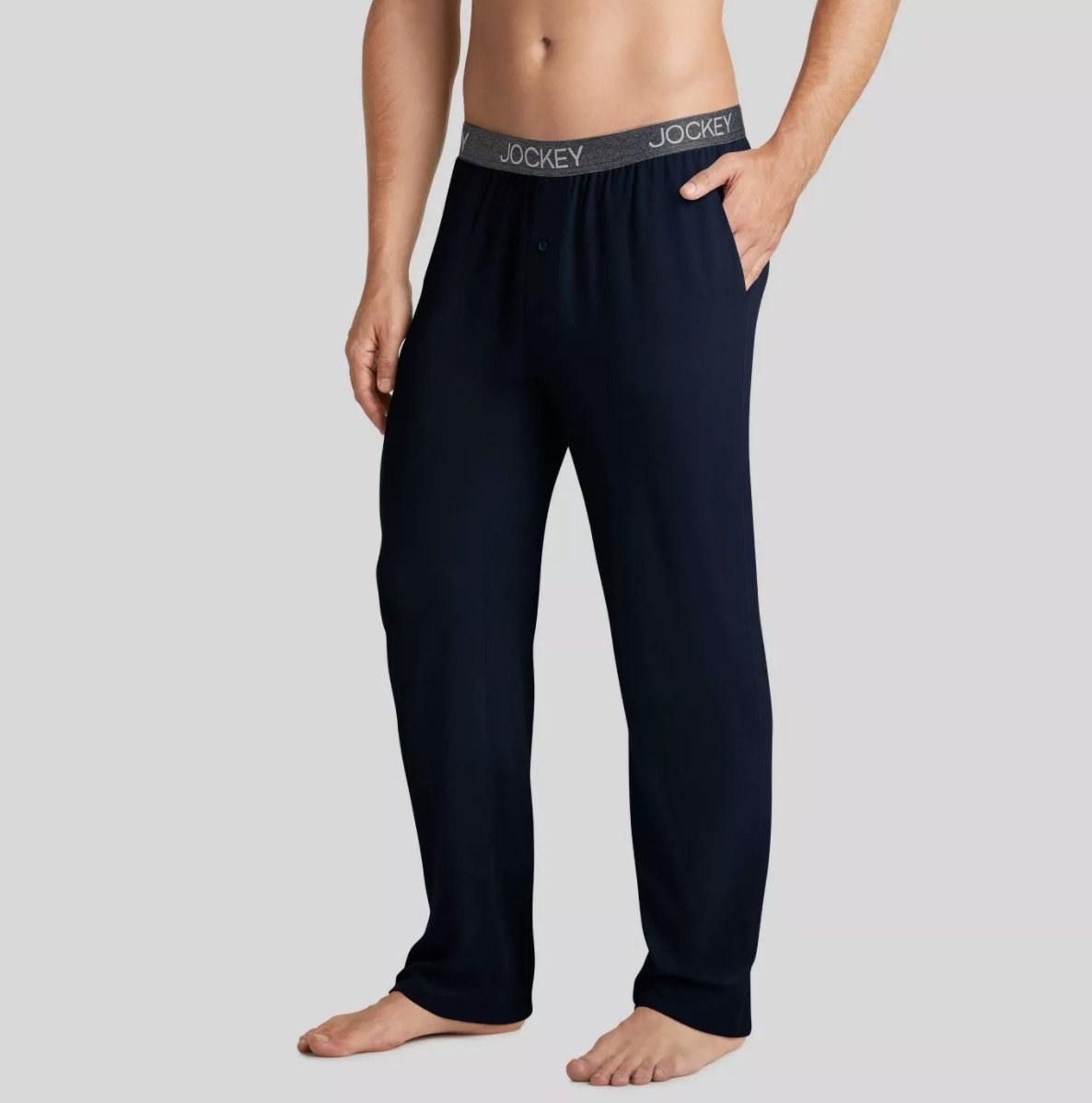 Model wearing the black pajama pants with a Jockey waistband