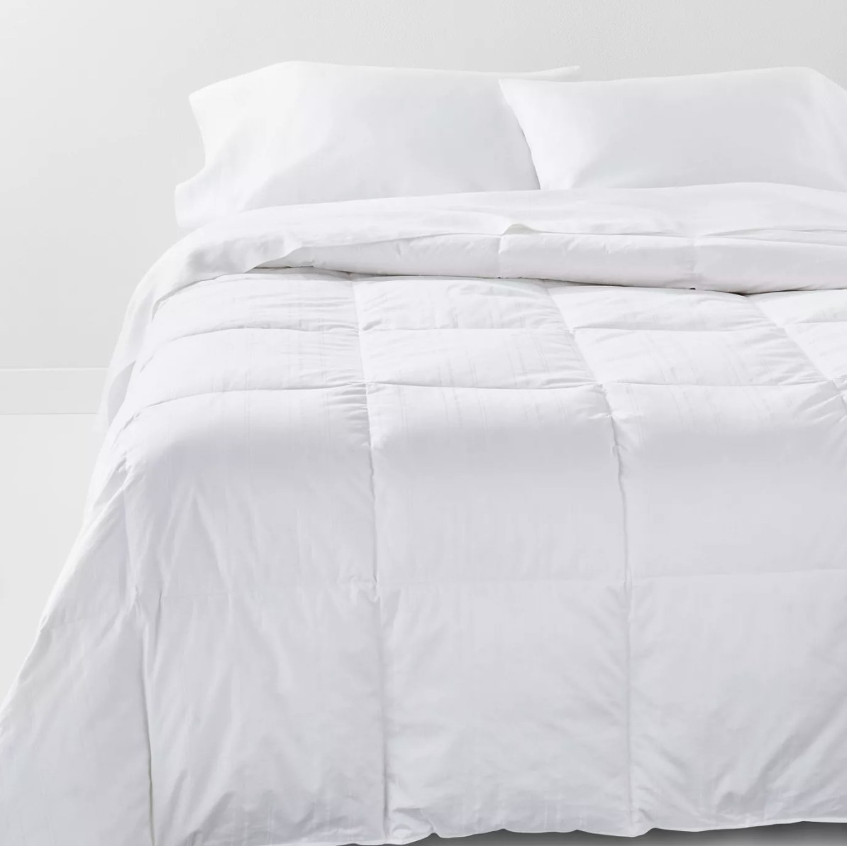 The white quilted down comforter