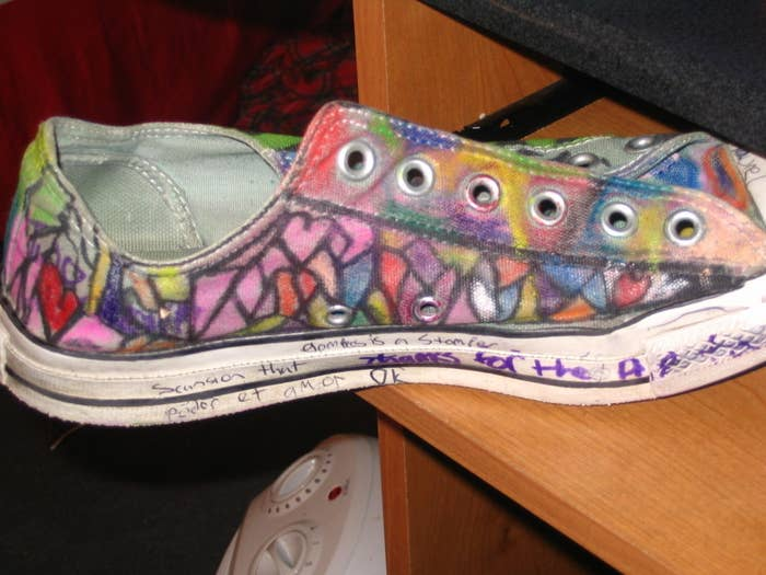 A pair of Converse low tops filled with colorful doodles and handwritten messages