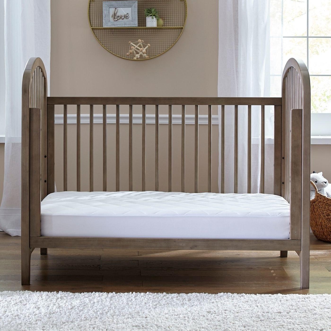 The crib mattress pad in a crib