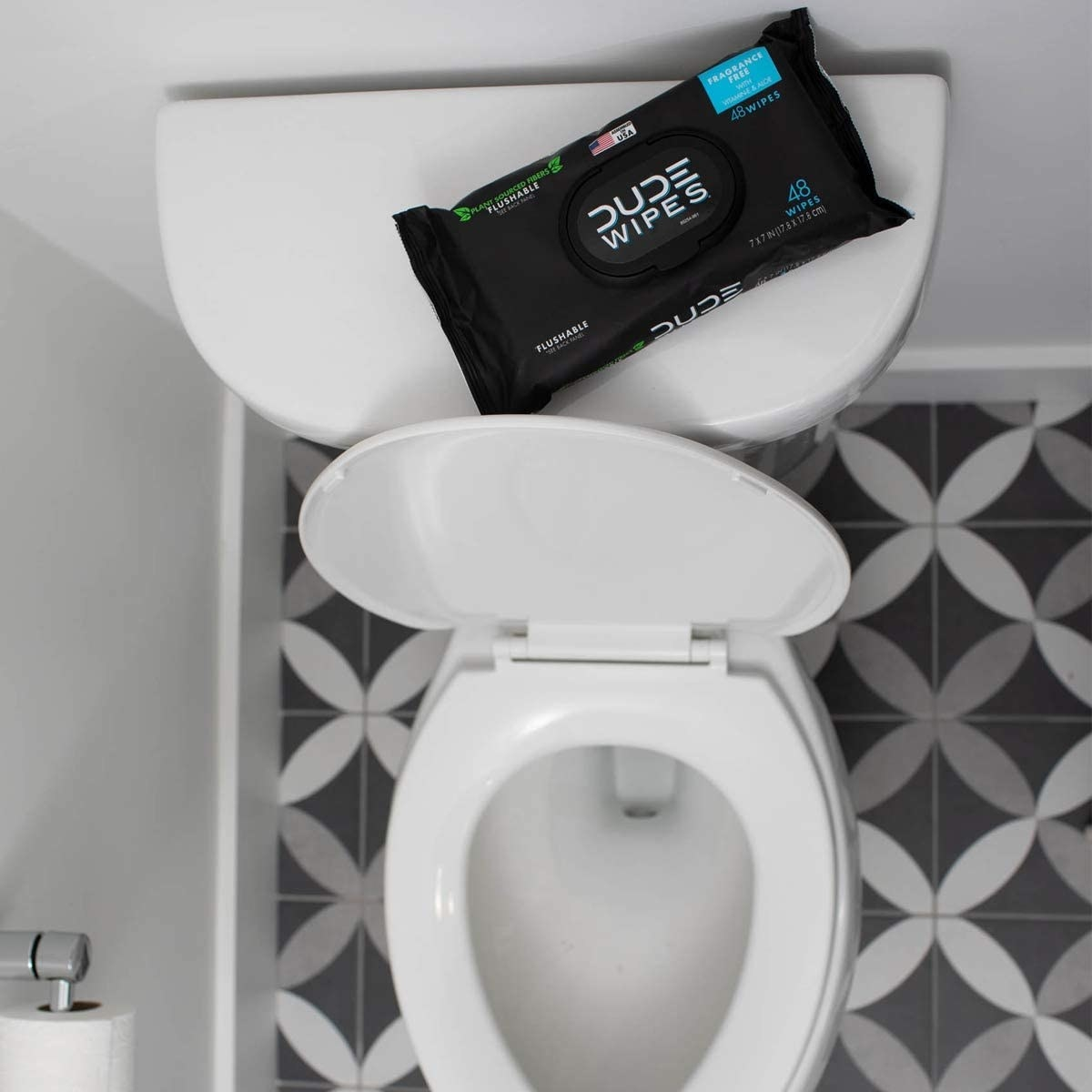 pack of Dude wipes on a toilet