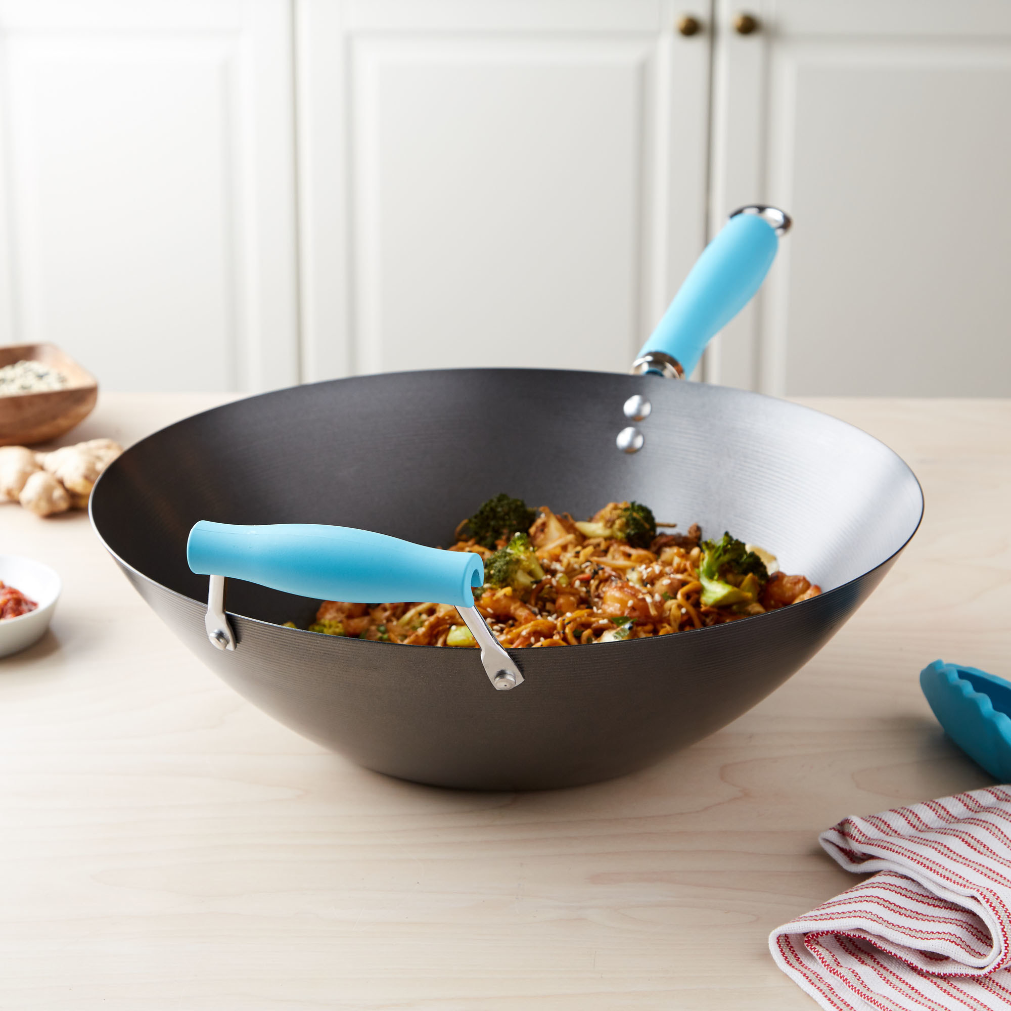Product photo showing Tasty carbon steel 14'' non-stick wok with helper handle in blue