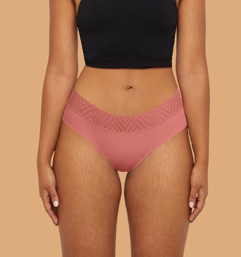 Model wearing the underwear in pink with v-style mesh band around the top