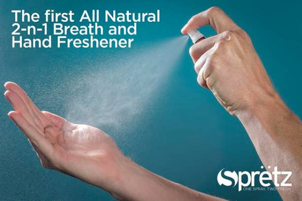 person spraying hand with the product