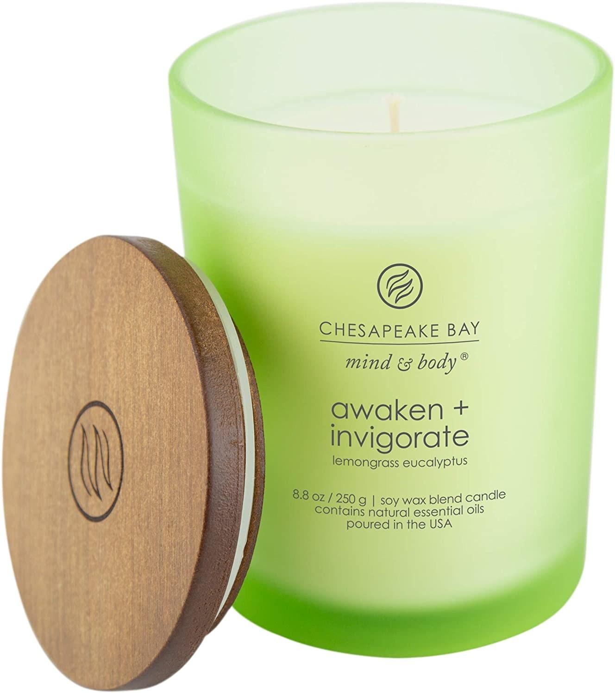 """A green """"Awaken + Invigorate"""" candle"""