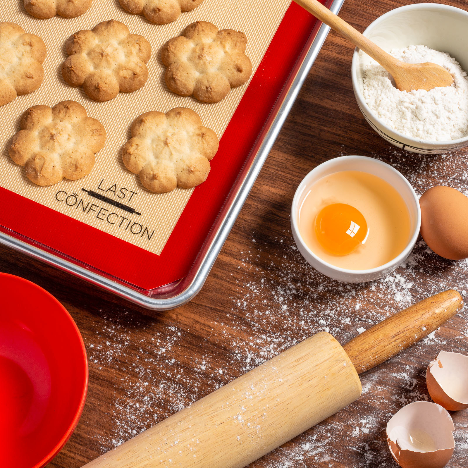 Product photo showing Last Confection Silicone Baking sheets on a sheet pan with cookies