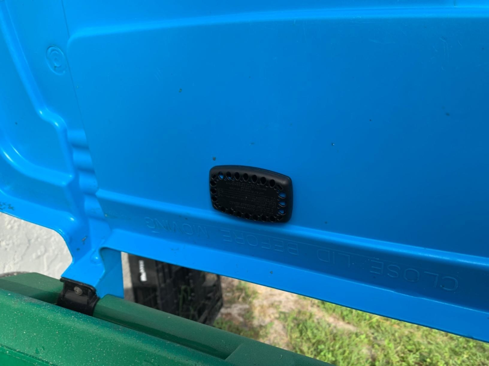 Reviewer photo of the rectangle guard in black attached to the inside of a garbage can lid