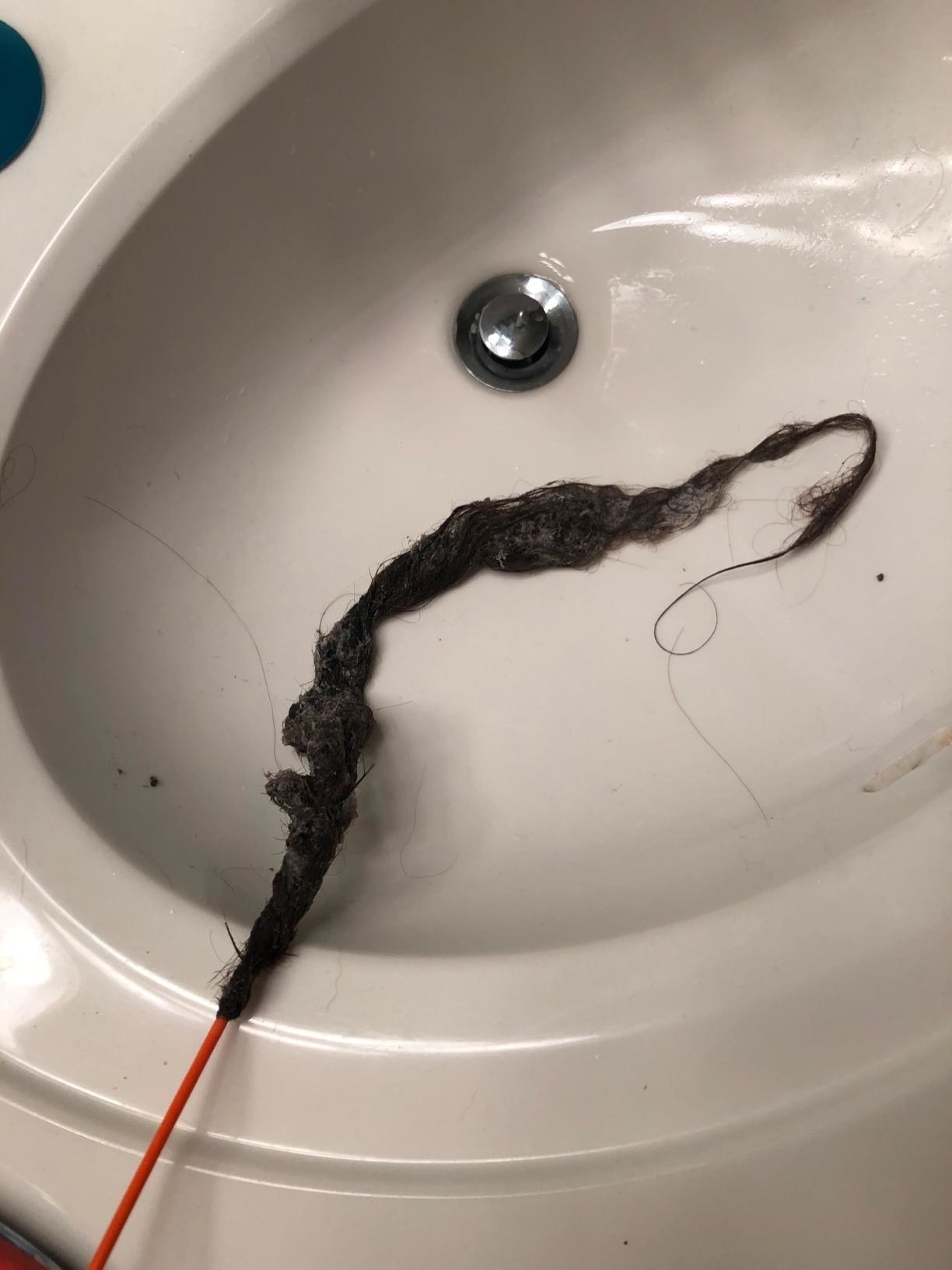 Reviewer pic of the wire-like FlexiSnake with a huge club of wet hair on the end