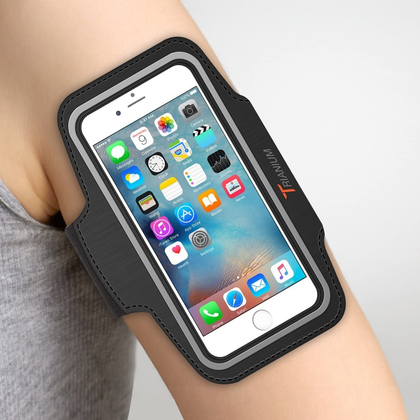 Someone's arm with an iPhone in the armband case.