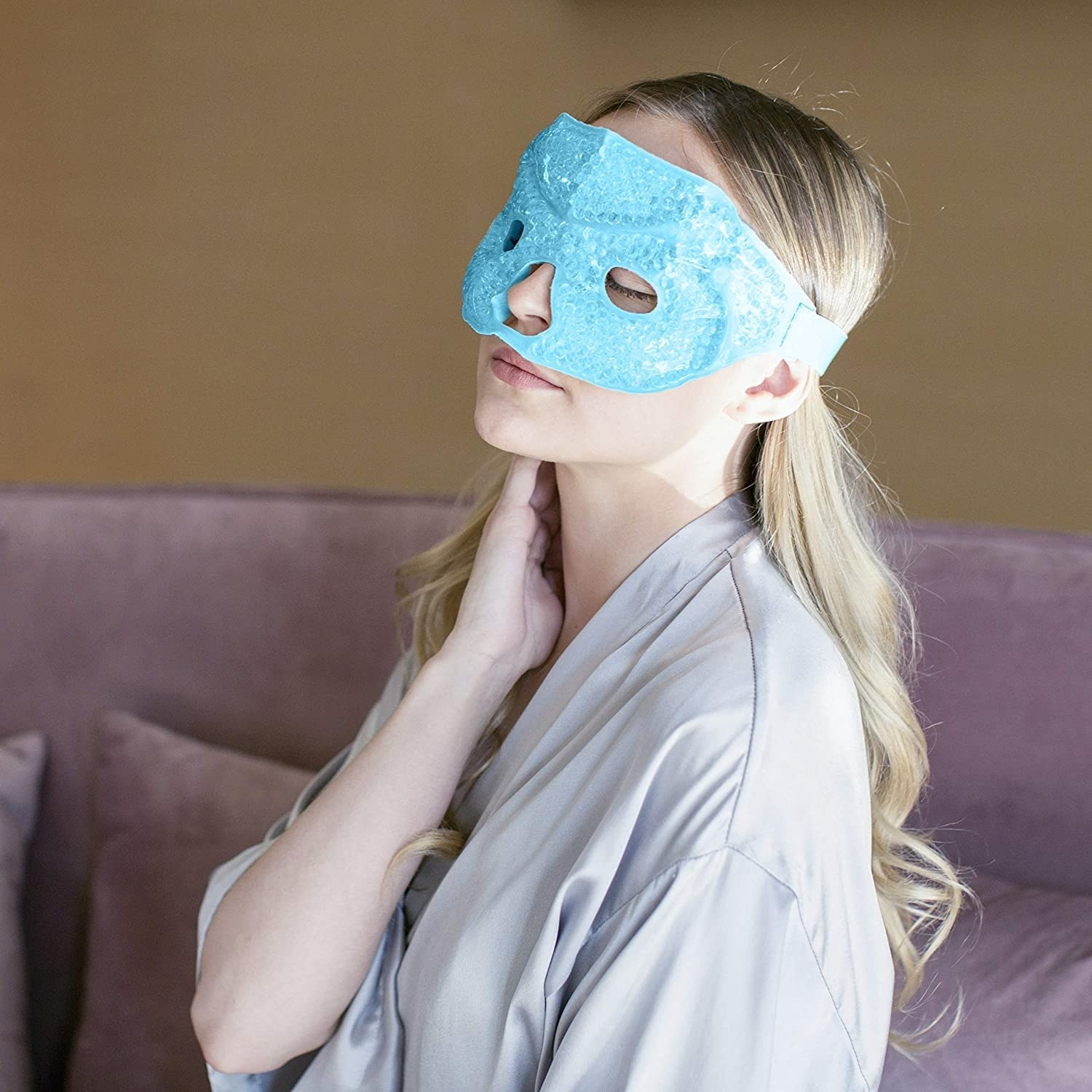 A person relaxes with the gel eye mask