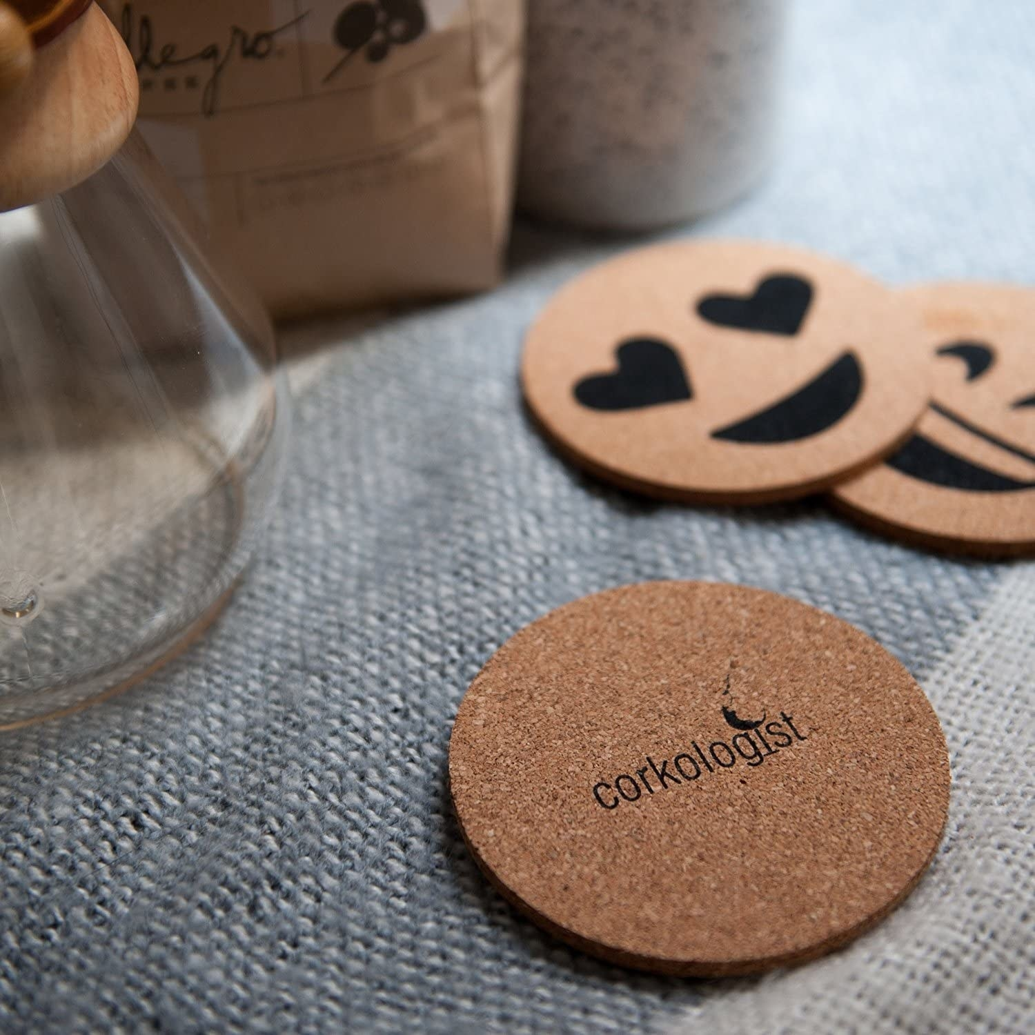 A close up of the emoji coasters on a tablecloth