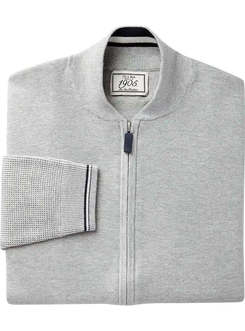 A light gray zip-up sweater jacket with black and white trim on cuffs and inside collar